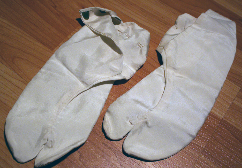 These were acquired by my grandmother when she was living in occupied Japan with my grandfather who was in the Air Force. Object: Silk Toe Slippers Age when Given: 15 Location: Los Angeles, California Submitted by: Laurel Bybee