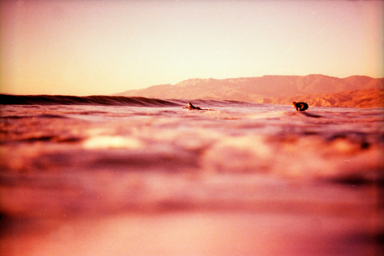 shakasandsinglefins: Ocean Beach, cross processed 35mm film.  Testing out the old Nikonos after many months of non-use.