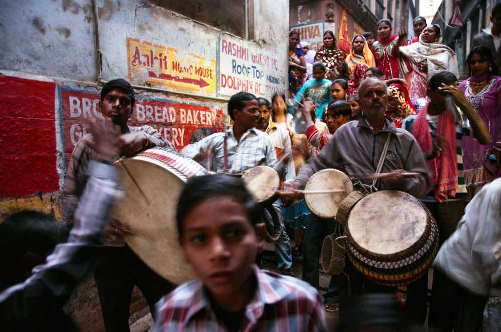Pre-wedding celebrations weave through the streets of Varanasi, Uttar Pradesh India. Belief in taboos meant that widowed women were not permitted to attend wedding ceremonies as their presence was thought to be unlucky for the new couple.