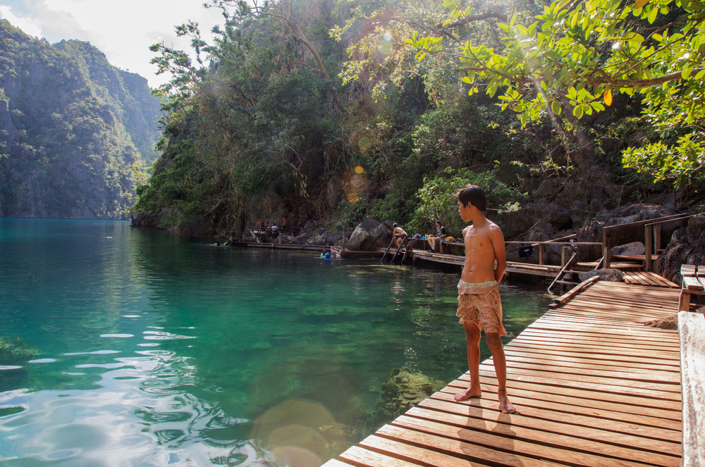 A young Tagnabua boy looks out at Kayangan Lake on Coron Island, a popular tourist destination in Northern Palawan. The Tagbanua have ancestral domain rights on Coron and surrounding waters but they are at risk of development and pressure from the government who wish to profit from the popular tourist site.