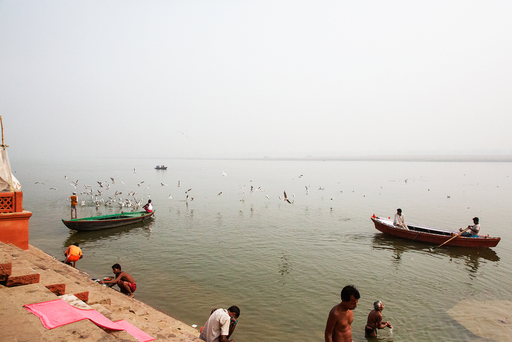 Morning bathers washing in the sacred Ganga River in Varanasi Uttar Pradesh, India.
