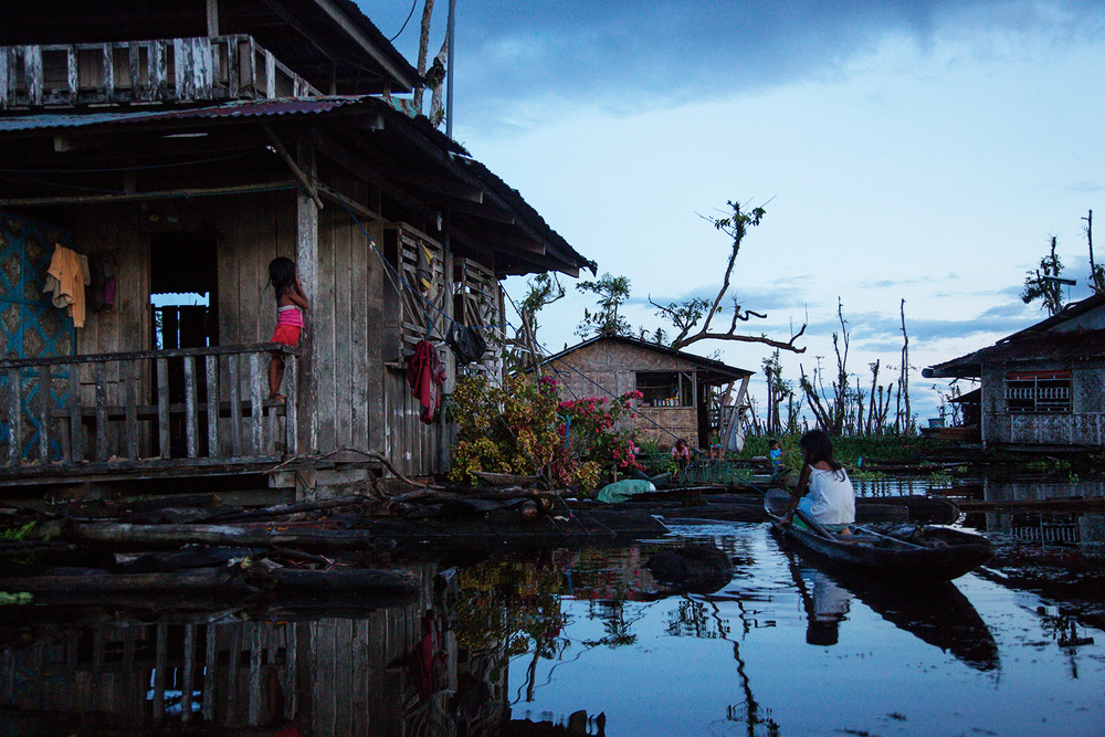 The sun sets in the Monobo floating village in Agusan Marsh in Mindanao, the Philippines.