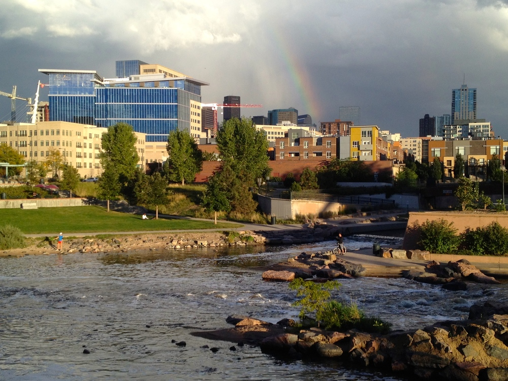 The Denver skyline and a rainbow over Confluence Park