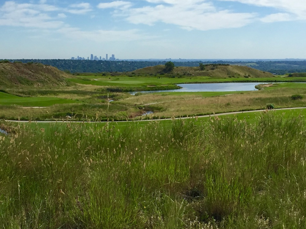 The Denver skyline on the horizon as seen from the trail beside Homestead Golf Course