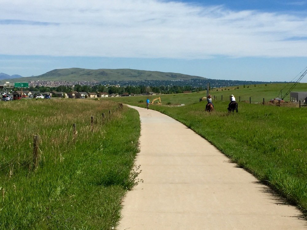 Sometimes motorists, cyclists, and even equestrians share the trails around Denver