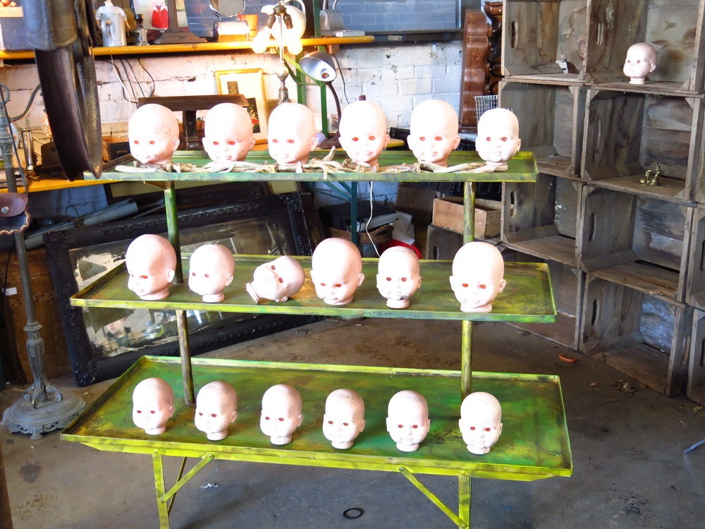 Who doesn't need a collection of eyeless baby doll heads?