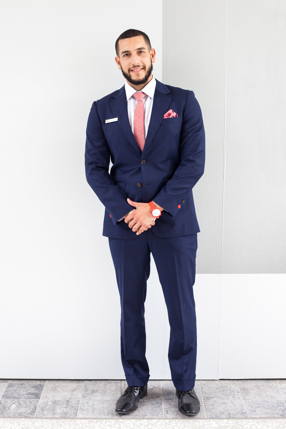 Men's navy suiting with red detail