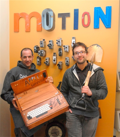 John Scaletta, left, and Craig Bass pose for a shot at Motion Source Video Solutions, 40 S. La Grange Rd. in La Grange on Friday, Feb. 8, 2013. The two co-wrote and co-directed the film, iDig in La Grange, which tells the story of one man's attempt to dig up a time capsule from the 1970's that contains an original Apple 1 computer. (Matthew Piechalak – mpiechalak@shawmedia.com )
