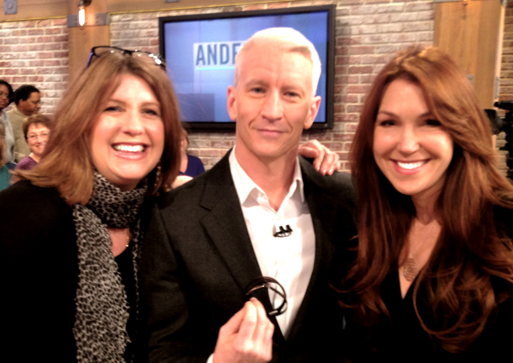 One Meaning with Anderson Cooper (with our Dragonfly Wrap Bracelet).  His dog Molly has one of our 813 pet tags too.  We love Anderson!