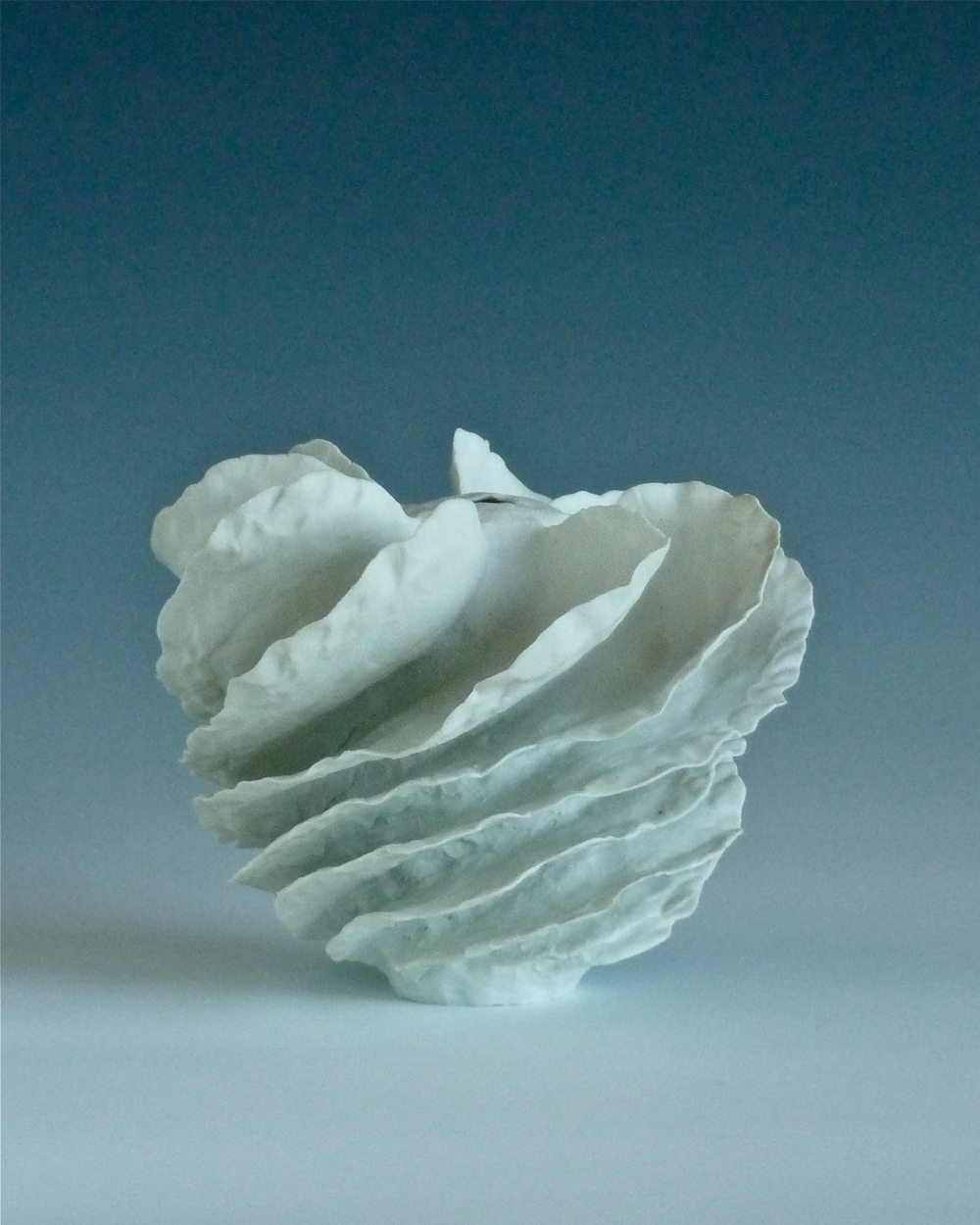 Spiral porcelain flanged form