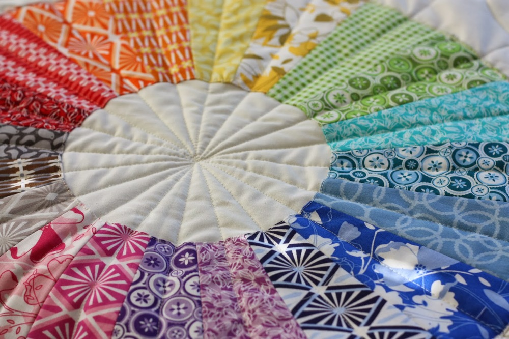Dresden Circle Quilt from Diary of A Quilter.  Featuring Jenean Morrison's True Colors and Wishing Well fabrics.