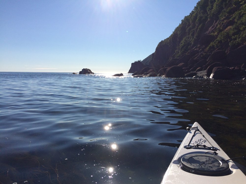 This picture was taken at the base of Cape Smokey on a beautiful August morning in 2016. At the time, there had been reports of Great White Sharks sighted off the coast of NS - a thought that hadn't struck me until I was pretty far offshore in a kayak that looks (I would imagine) like a white, juicy seal from an underwater vantage point. I couldn't get the cover of Jaws out of my mind and it kind of ruined the rest of the paddle.