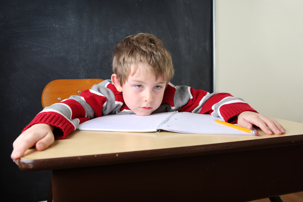bigstock-Tired-and-bored-student-22669502.jpg