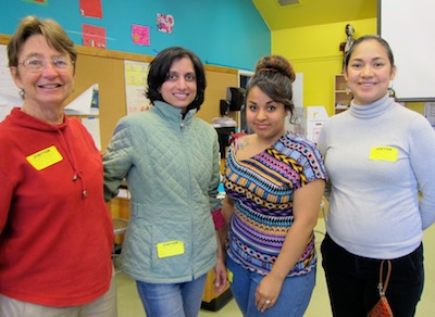 These volunteers helped 7th graders dissect cow's eyes.  From left to right - Ann Reisenauer, Ulka Vijapurkar, Mayra Cardenas and Veronica Gonzalez.  Mayra has an 8th grade  nephew attending Belle Haven.  Ann, Ulka and Veronica belong to the Association of Women in Science and seek to encourage young women to consider science as a profession.