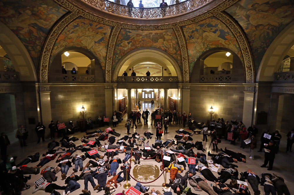 "Protesters stage a ""die in"" at the Missouri State Capitol on Wednesday, Jan. 7, 2015."