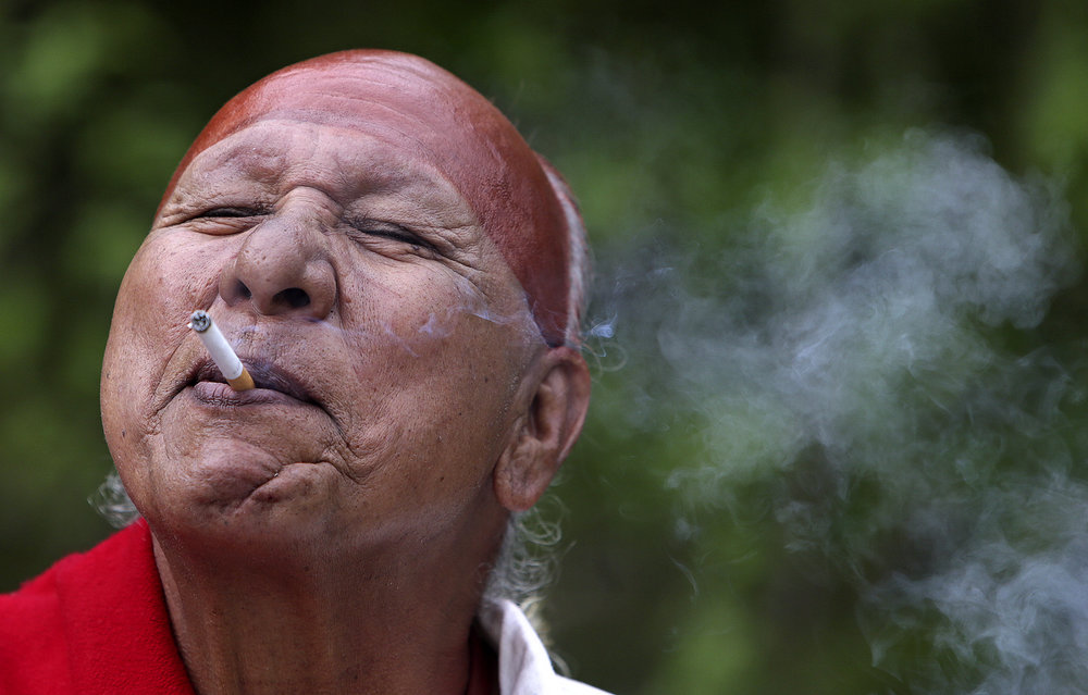 John Sumpter, 63, of Copan, Okla. a member of the Delaware tribe, takes a smoke break before the filming of scenes in a reenactment for the revamped Gateway Arch museum at the August A. Busch Memorial Conservation Area on Friday, April 29, 2016.