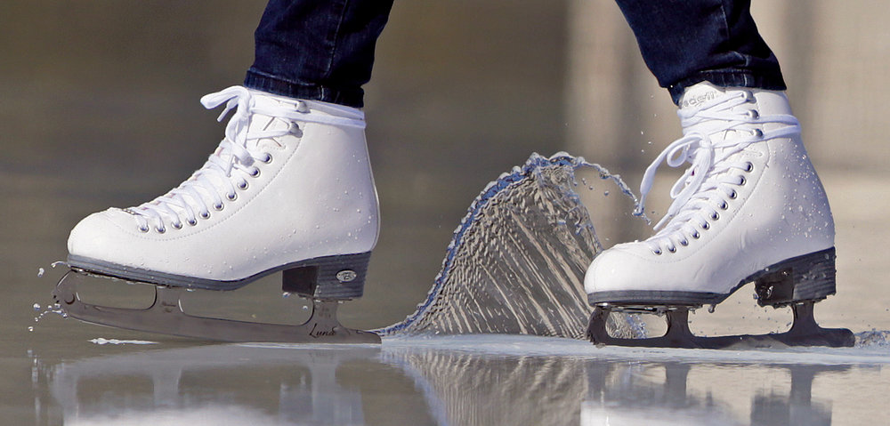 "Temperatures in the 70s may have turned Steinberg Skating Rink in Forest Park into a large puddle, but it didn't stop Karen Nugent, of Sappington, from enjoying a skate on Friday, Feb. 19, 2016. ""My goal today was to break in my new skates and stay above water,"" said Nugent. Steinberg closes for the season on Thursday, Feb. 25."