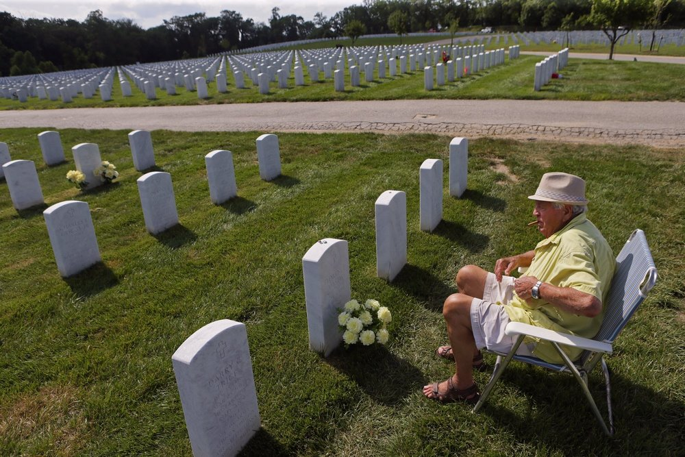"Frank Mastis, 83, an Air Force veteran who served in the Korean War, visits his wife's grave in Jefferson Barracks National Cemetery on Thursday, June 25, 2015. ""She liked yellow so I try to wear yellow,"" said Mastis. Officials say that the cemetery will run out of plots between 2021 and 2027 at the current burial pace. Area veterans are looking to annex 38 acres of neighboring Sylvan Springs Park from St. Louis County for use by Jefferson Barracks."