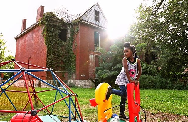 Mercedes Reeves, 5, is under the watchful eye of her grandmother, Sheree Moore, as she plays in the shadow of vacant homes that surround Moore's longtime home on Maffitt Avenue in St. Louis on Thursday, Sept. 6, 2018. This image is a screengrab from a video I got to do for our Tipping Point series on vacant houses. #onassignment #stltoday