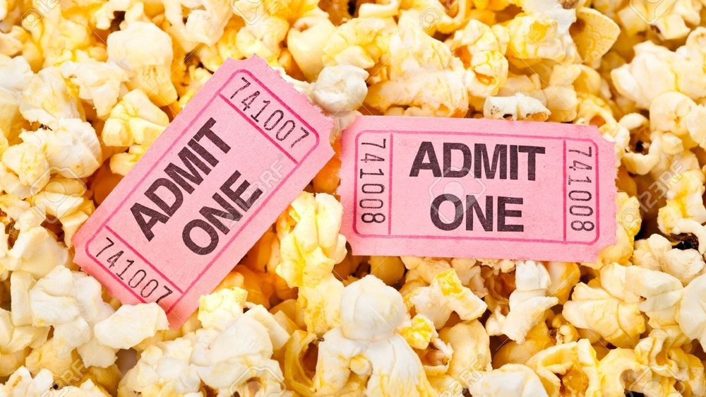 12461004-Movie-tickets-in-a-pool-of-freshly-popped-popcorn-Stock-Photo.jpg
