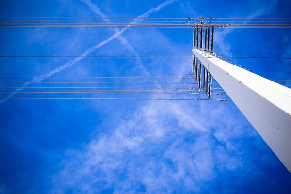 Looked out my hotel room window one morning and was struck by the color of the sky, the power lines, and the clouds.