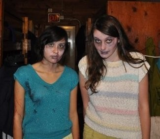 """Maegan Houang & Grace Kredell at Wesleyan University in 2010 working on Pete Binswanger's senior thesis film """"Nice Guys Finish Dead."""" (We are dressed up as dead bodies for the dead body pile.)"""