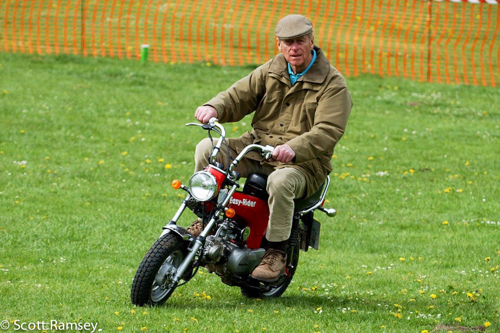 Prince Philip Riding A Morobike