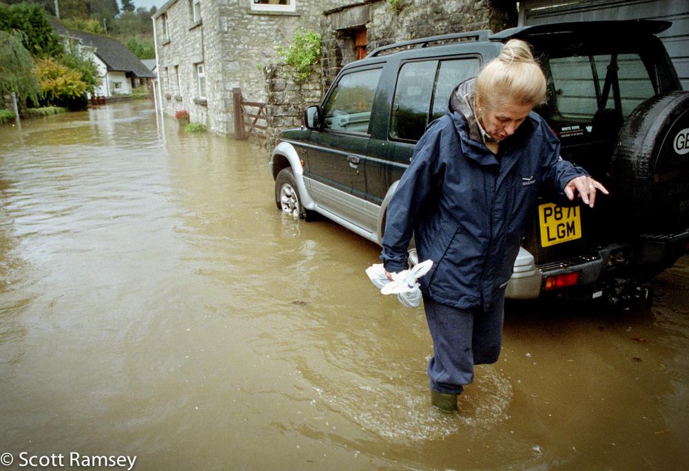 Woman Walking Through Flood Wales