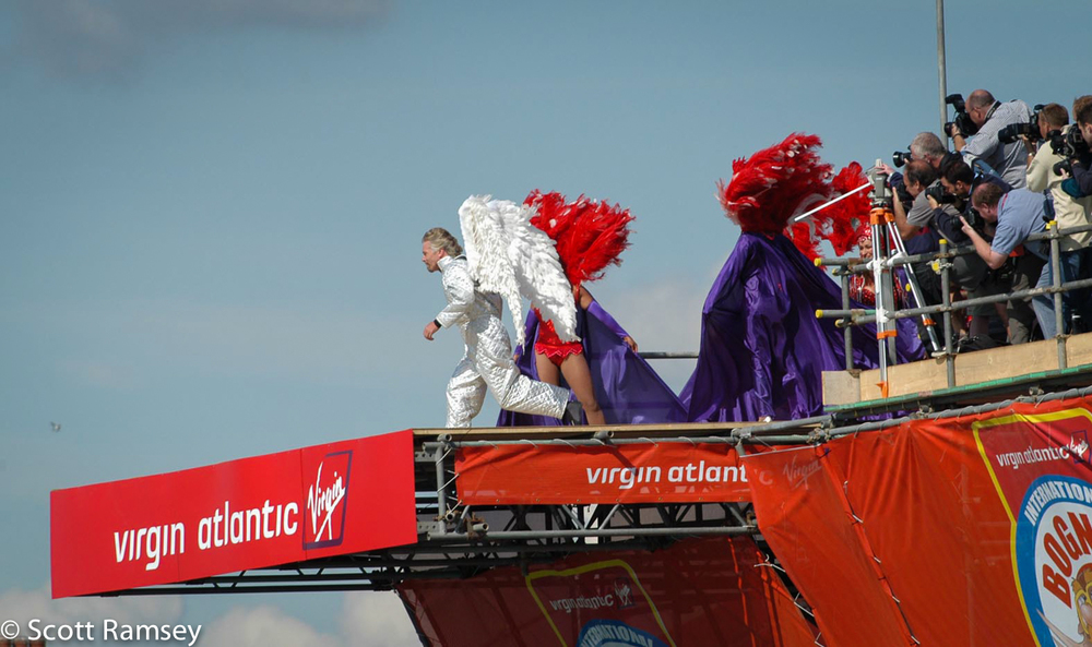 Richard Branson dressed in a silver suit and wearing wings runs off the pier whilst taking part in the Bognor Birdman contest in West Sussex.