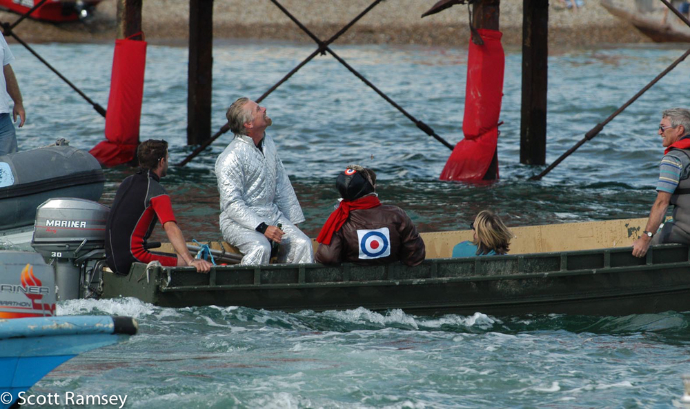 Safe in a rescue boat, Richard Branson heads back to the shore after jumping off a pier during the Bognor Birdman contest in West Sussex.