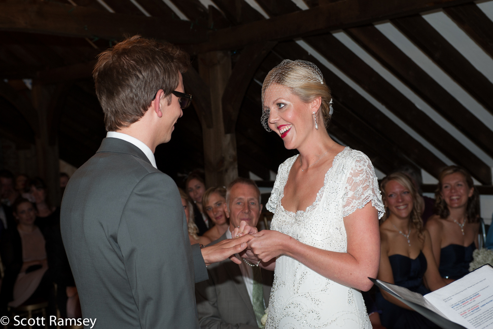 A Bride and Groom exchange rings during their wedding at Blackstock Farm Barn in Hellingly, East Sussex.