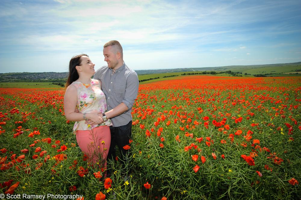 Couple In Poppy Field East Sussex