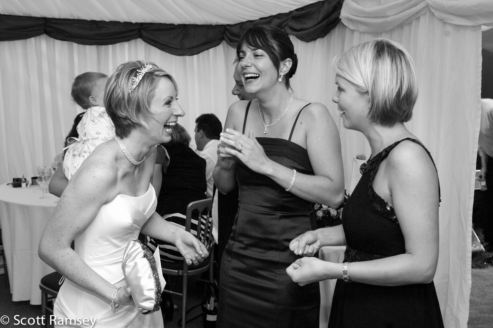 Bride Laughs With Guests