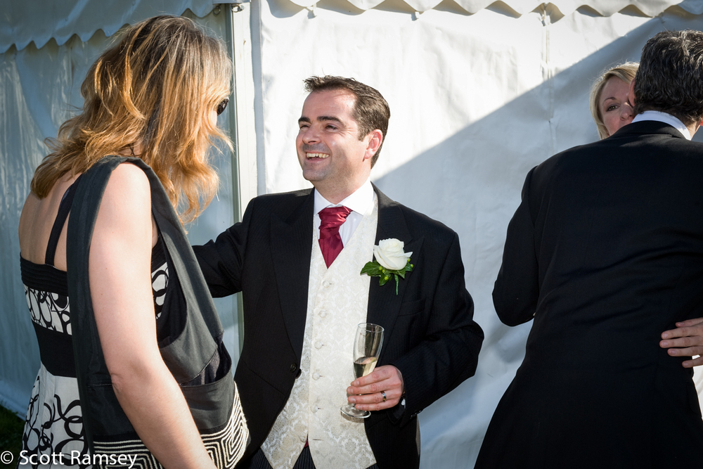 Groom Welcomes Guests