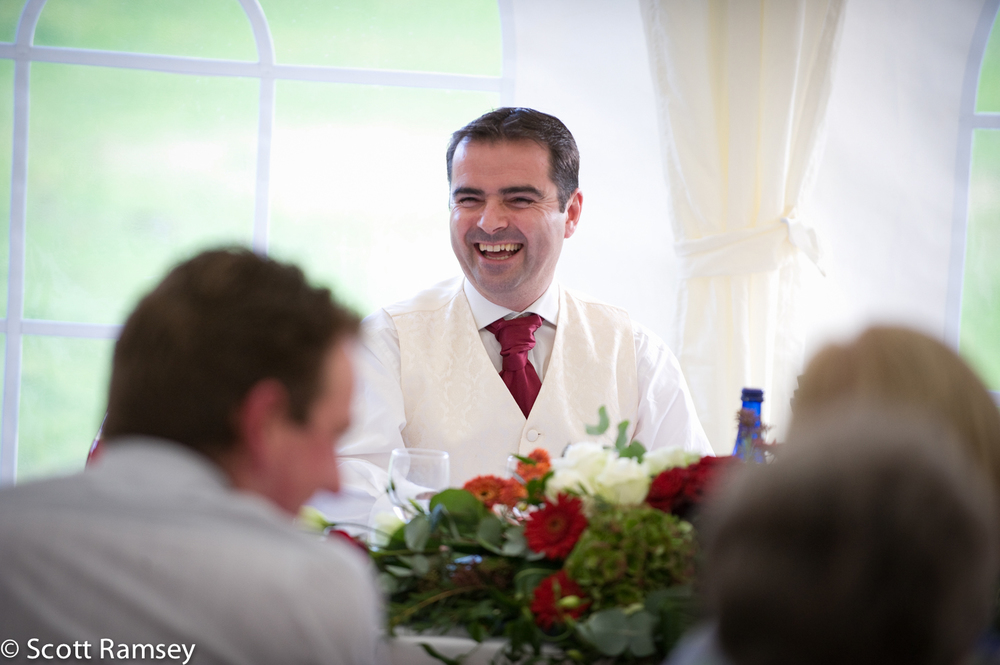 Groom Laughs During Speech
