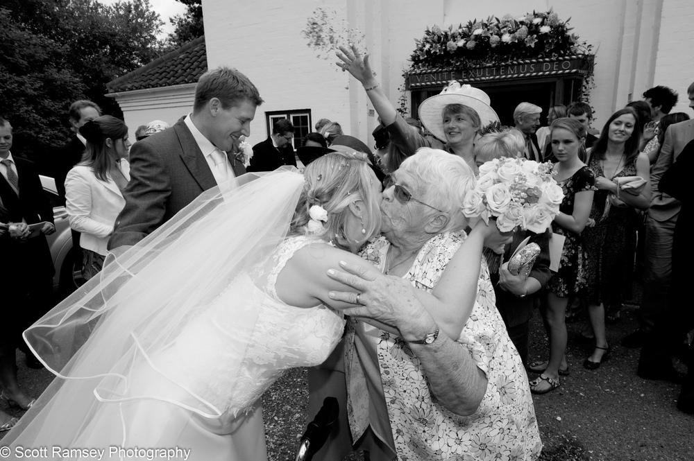 Bride Kisses Guest