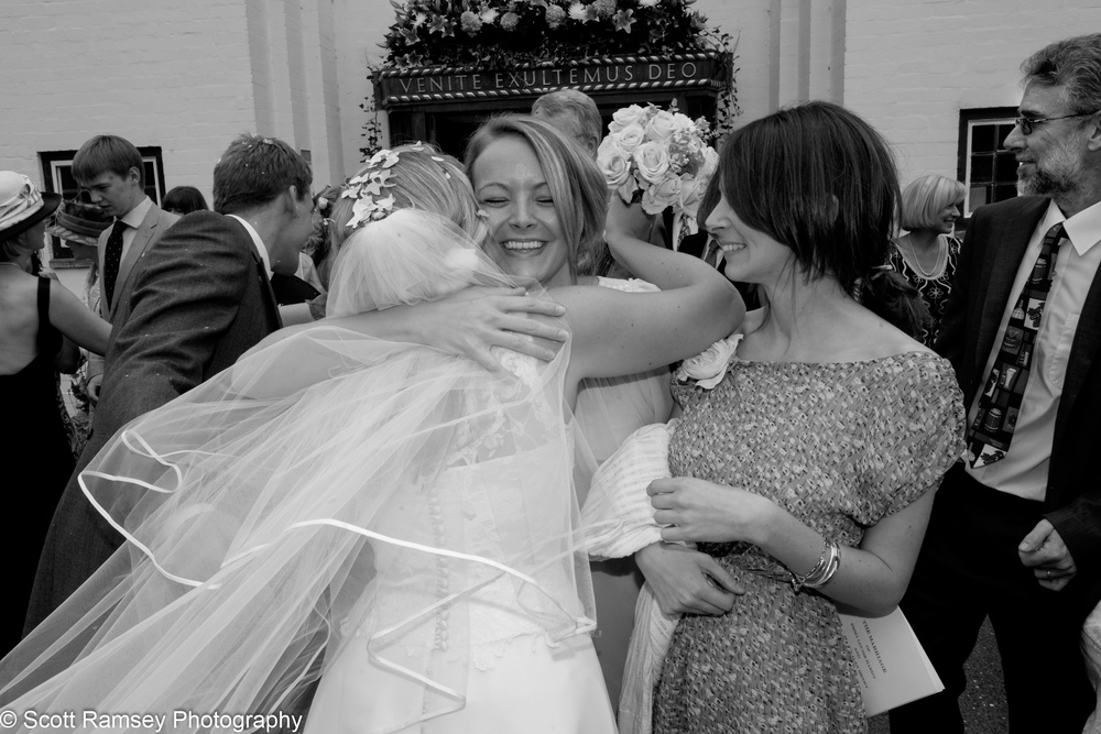 Bride Gets a Hug From Guest