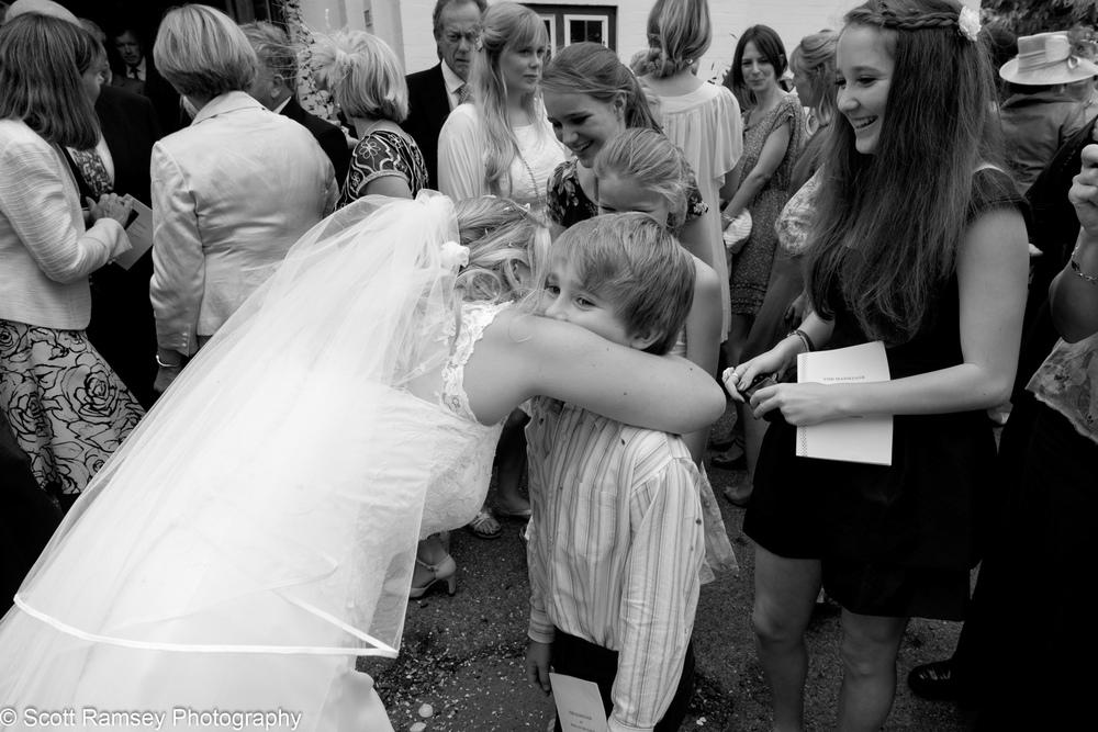 Bride Hugs Boy