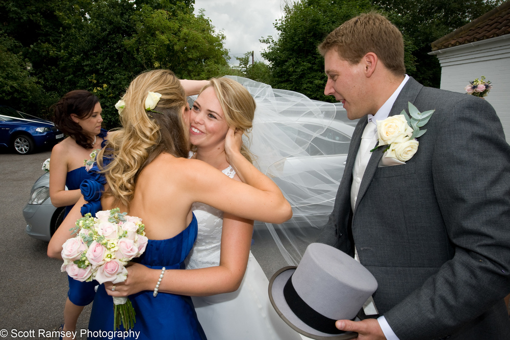 Flower Girl Hugs Bride