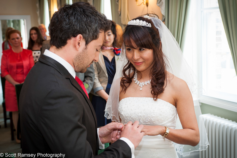 Portsmouth Registry Office Wedding Bride Looks At Groom 040513-14