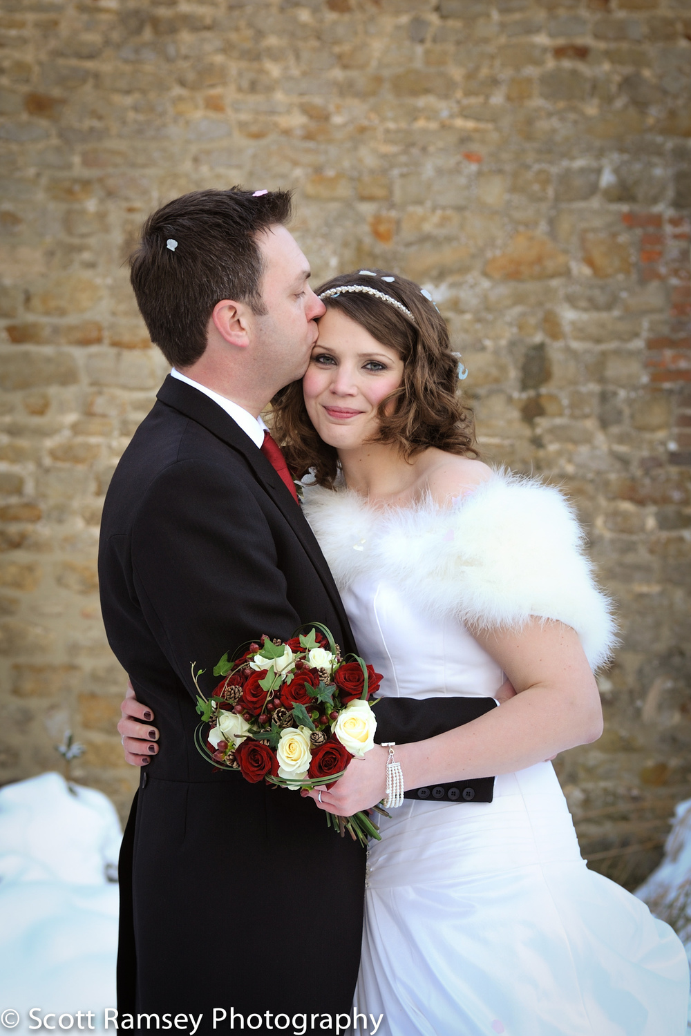 Winter-Wedding-Spread-Eagle-Hotel-Midhurst-Bride-Groom-Kiss-In-S