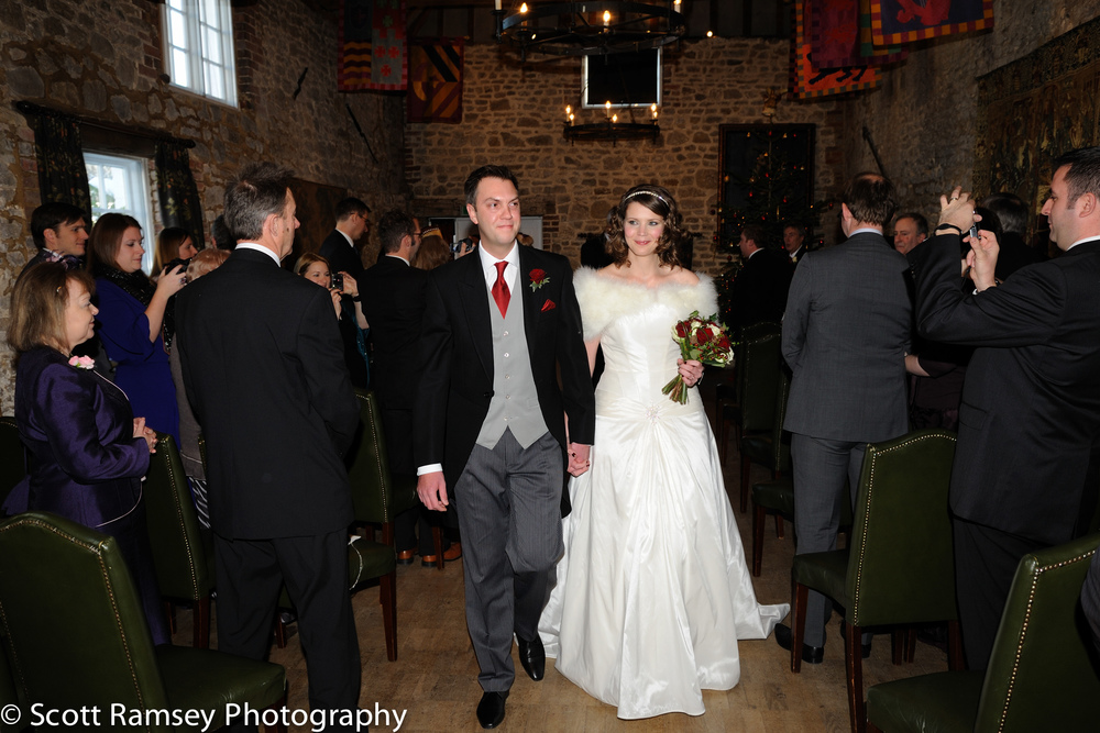 Winter-Wedding-Spread-Eagle-Hotel-Midhurst-Bride-Groom-Walk-Down