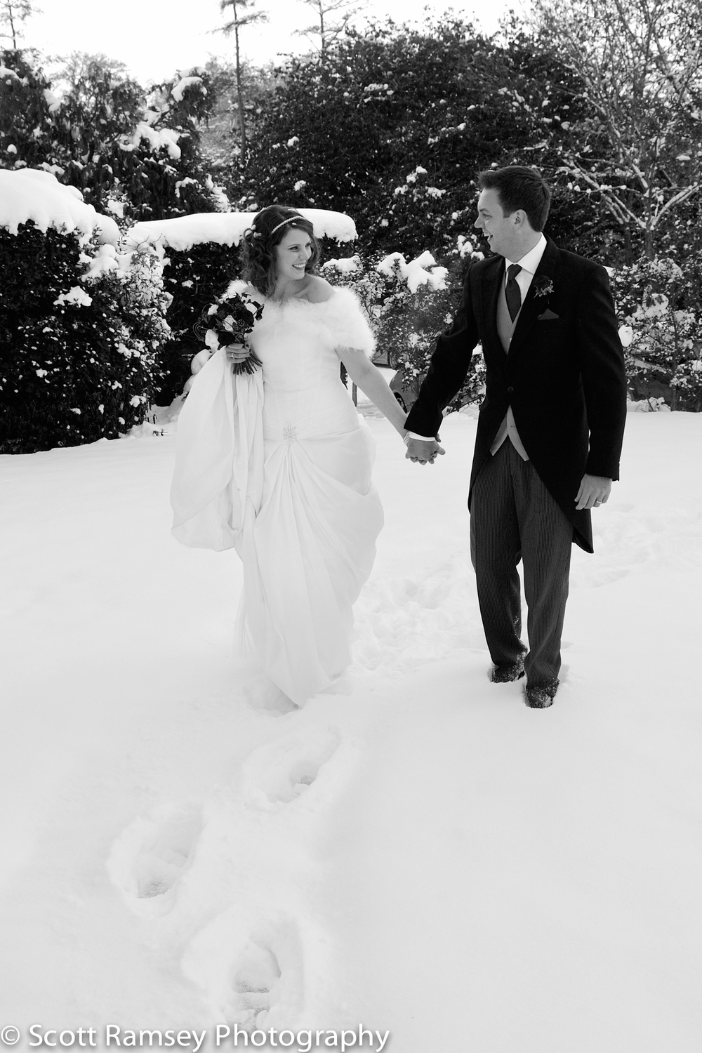 Winter-Wedding-Spread-Eagle-Hotel-Midhurst-Bride-Groom-Walk-Hold