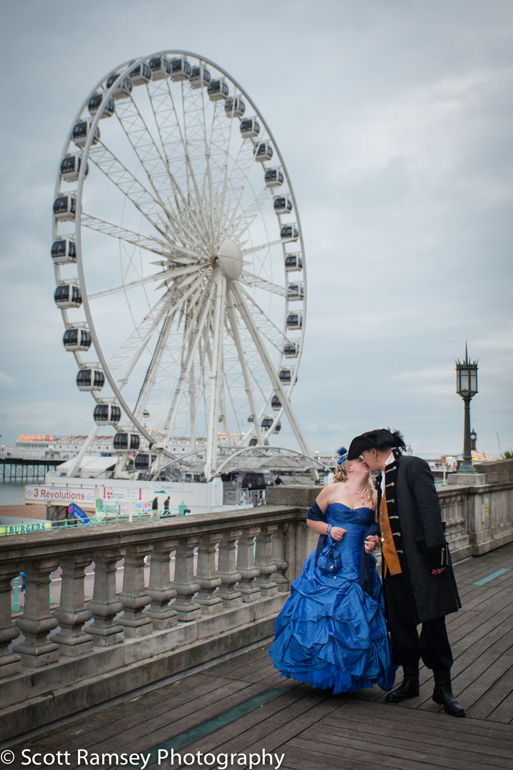 Brighton-Wedding-Photography-Pirate-Theme-Bride-Groom-Kiss-Wheel