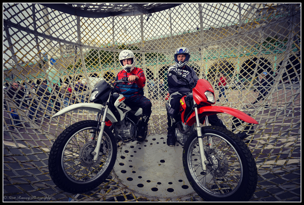 Wall and globe of death riders Jake and Junior Messham photographed in Brighton.