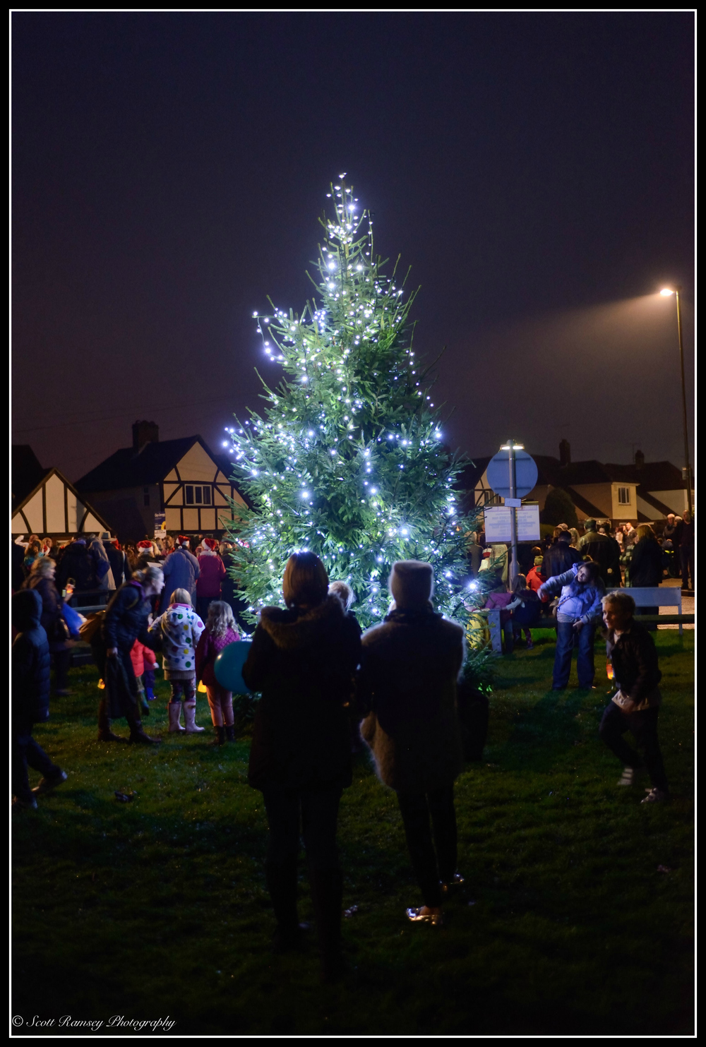 The East Preston Christmas lights switch on 2014. Local residents in the West Sussex village watch as the Christmas tree lights are turned on during the event.