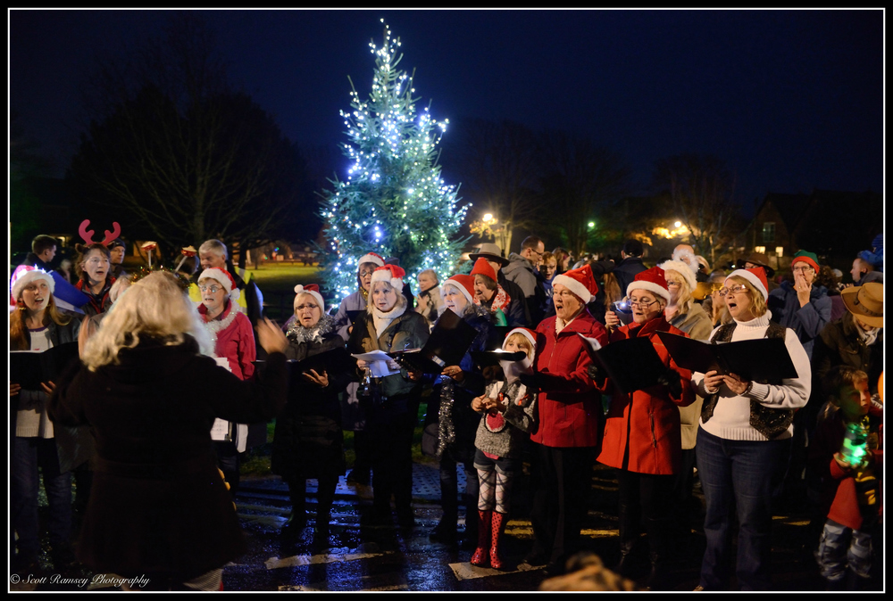 Carol singers perform in front of a Christmas tree during the East Preston Christmas Celebrations.