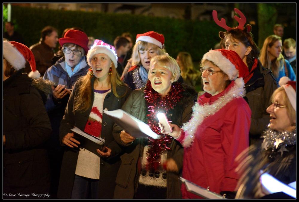 Carol singers sing traditional carols during the christmas