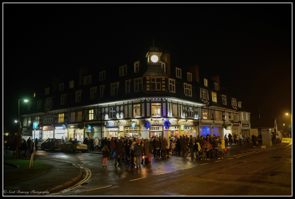 The Clockhouse Bar and shops lit up with Christmas lights in East Preston, West Sussex.