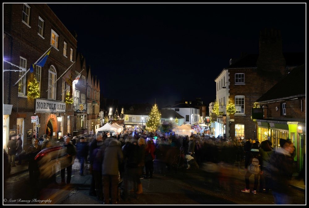 Arundel By Candlelight. The High Street and town is filled with people as they enjoy the annual Christmas event.